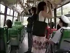 She strokes him and he fingers her on the bus tubes