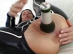 Bottle of beer inside the latex girl's ass tubes