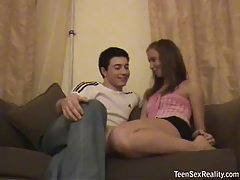Teen and boyfriend on the couch tubes