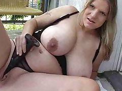 Busty chick uses a toy in her pussy tubes
