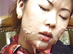 Japanese girl gets messy in bukkake tubes