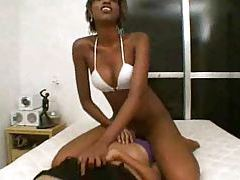 Black chick sits on the face of a white girl tubes