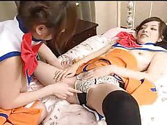Sultry Japanese girls in costume fingering tubes