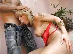 Hot tranny in red lingerie takes cock tubes