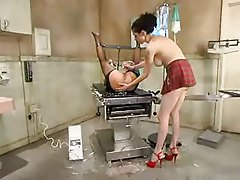 Bondage girl is given an enema tubes