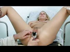 Doctor gives her a thorough pussy exam tubes