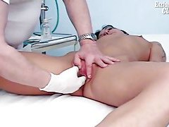 Gloved doctor hand fingering the girl tubes