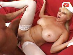Blonde nurse with big tits in stockings tubes