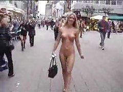 Walking the busy streets totally nude tubes