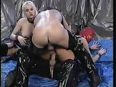 Freaking hot latex group scene with a DP tubes