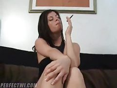 She smokes and gives a footjob tubes