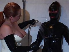 Chick in a full latex suit is played with tubes