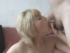 She loosens with a toy and then takes anal fuck tubes