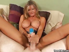 Chick with big tits giving a handjob tubes