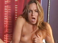 Stripping girl has a dildo for her pussy tubes