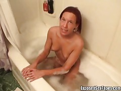 Babe in the bathtub gives her man head tubes