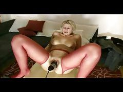 Pussy loosened with toy and fist tubes