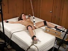 Girl tied down and toy fucked tubes