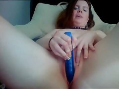 Naughty talking redhead with her vibrator tubes