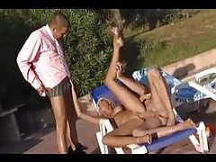 Bikini blonde with two guys by the pool tubes
