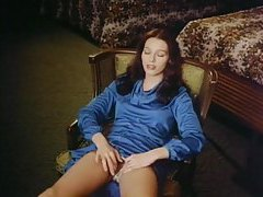 Girl in blue dress masturbates in vintage move tubes