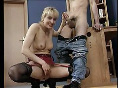 Blonde mom eagerly strokes his shaft tube
