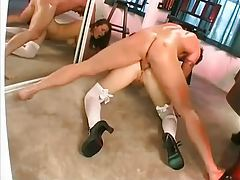 Girl in bow stockings fucked in both holes tubes
