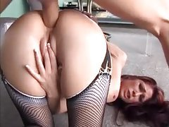 Redhead in fishnets banged in her ass tubes