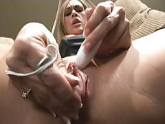 Close up as she masturbates and squirts tubes