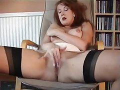 Redheaded milf in retro lingerie plays tubes