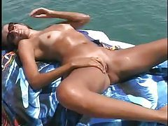 Bikini chick fucked on a boat tubes