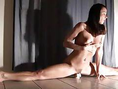 Flexible brunette does split and rides toy tubes