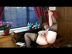 Solo chubby girl in stockings uses toy tubes