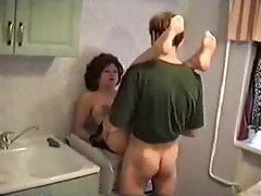 Sexy mom fucked in her kitchen tube