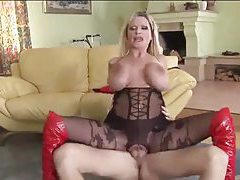 Enormous boobs on fucked blonde in body stocking tube