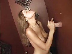 At a gloryhole she sucks a big dick tubes