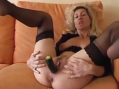 Milf shoves vegetables in her pussy tubes