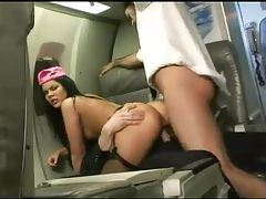 Stewardess in satin fucked on plane tubes