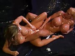 Lesbians covered in oil lick and toy tubes