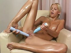 She oils up her body and plays with toys tube