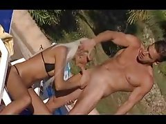 Incredibly hot blonde and her men outdoors tubes