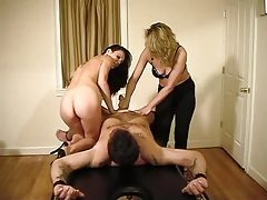 Bound guy gets hard handjob from girls tubes