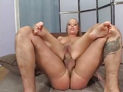A fat dick in her cunt and her ass tubes