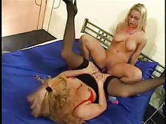 Milf and a young lady in glasses share toys tubes
