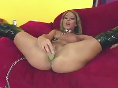 Chick in boots and on a leash toys her ass tubes