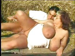 He sucks on her BBW tits outdoors tubes