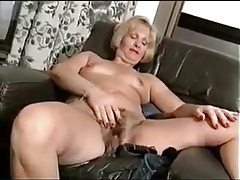 Curvy mature strips to nothing to show hairy pussy tubes