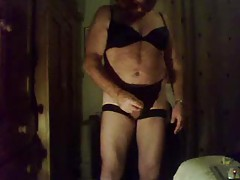 Fat crossdresser jerks off into condom tubes