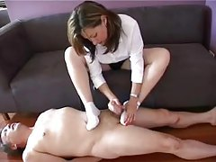 Girl in socks gives him a footjob tubes