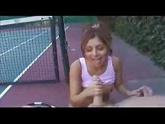 Tennis girl gives handjob on the court tubes